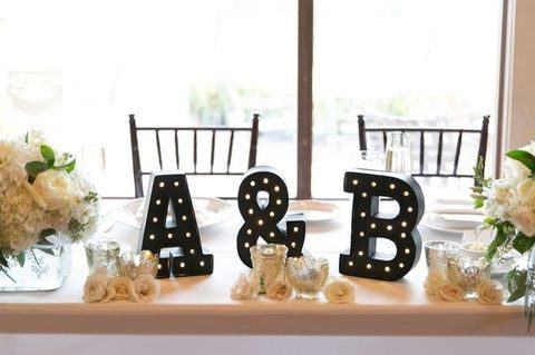 black marquee initials will contrast with an ivory table