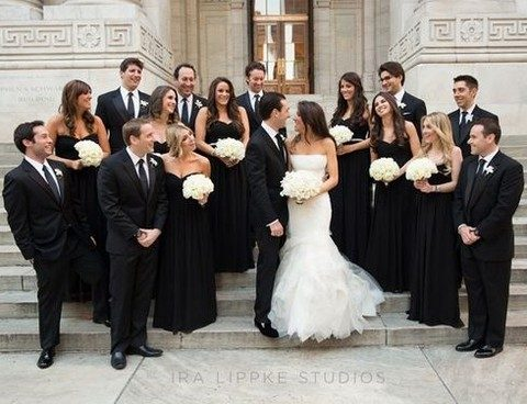 black maxi dresses for bridesmaids, black tuxedos for guys and a white mermaid gown for the bride