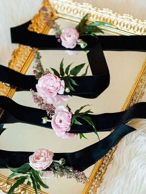 black ribbon and pink roses corsages
