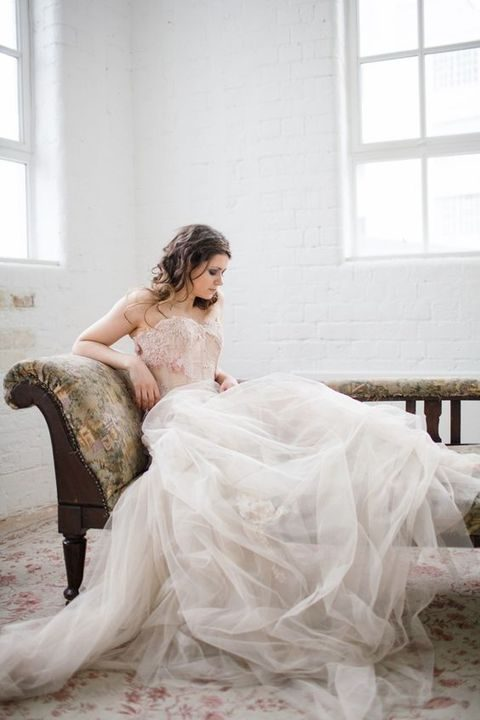 blush floral bodice and an ivory tulle skirt