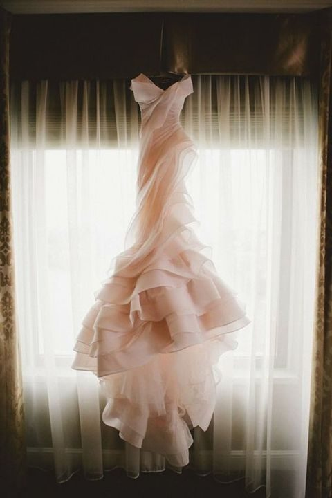 blush pink off the shoulder wedding gown with layers of tulle