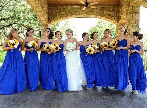 bold blue strapless dresses and sunflower bouquets