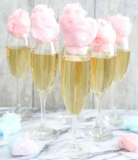 champagne with pink cotton candy toppers