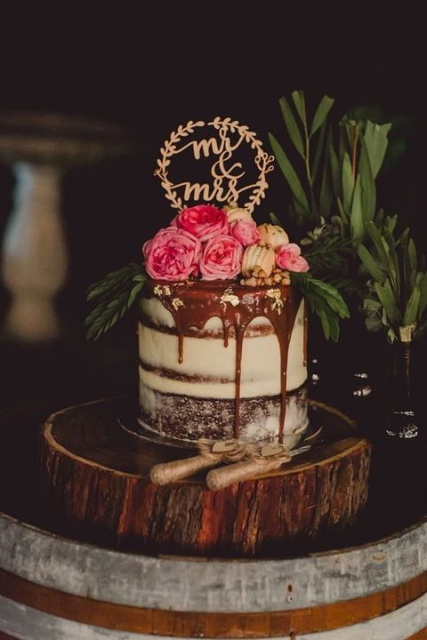 chocolate drip wedding cake with fresh flowers