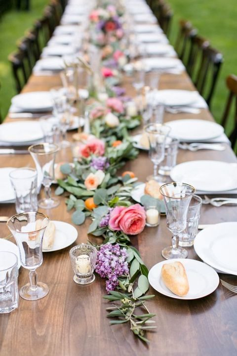 Colorful Florals And Greenery For A Garland On The Table