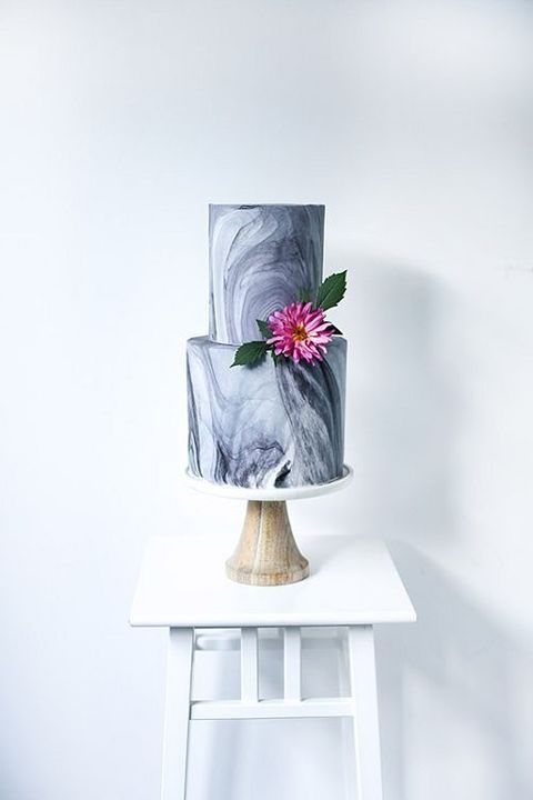 dark grey mable cake with a bold flower