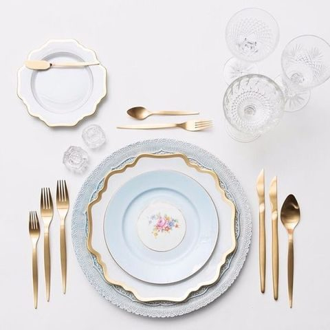 dusty blue lace chargers and plates, gold tableware