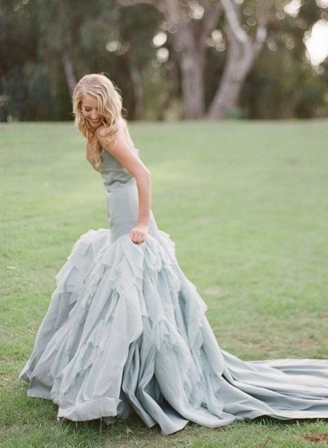 dusty blue wedding dress with a ruffled skirt