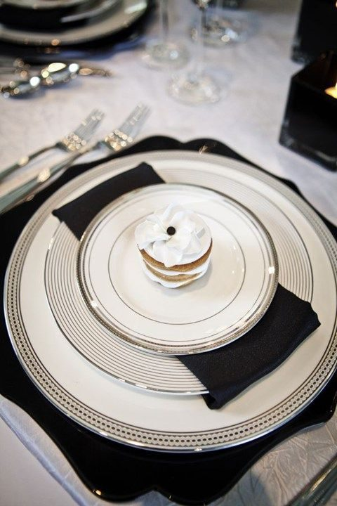 elegant black and white table setting with silver touches