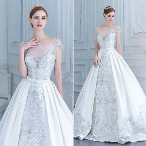 embroidered bead wedding dress with an illusion neckline and a detachable skirt