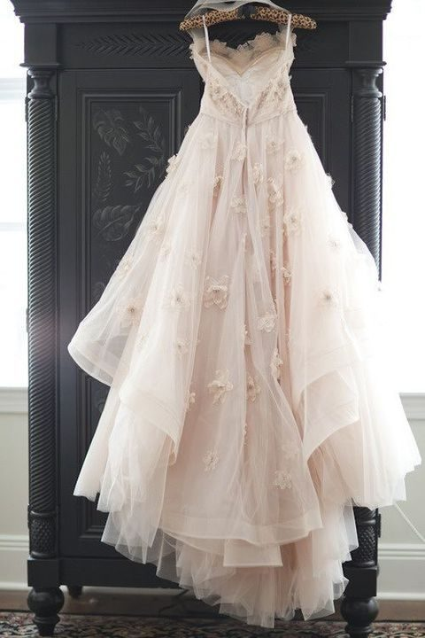fairy wedding dress in blush with flower appliques