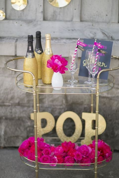 gold and fuchsia drink station