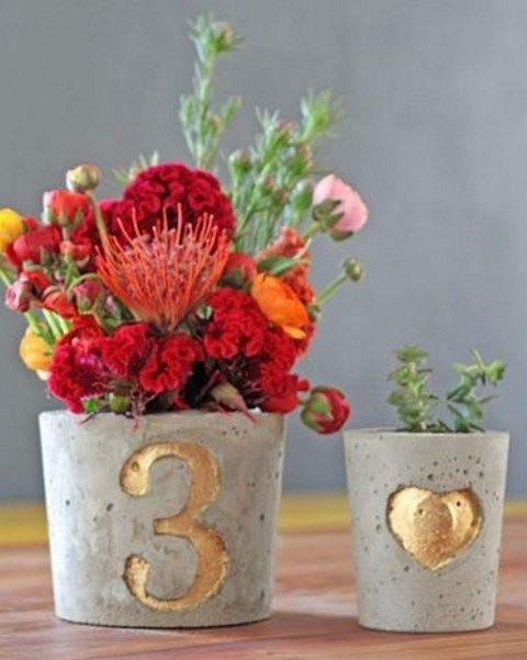 gold leaf concrete planters with table numbers