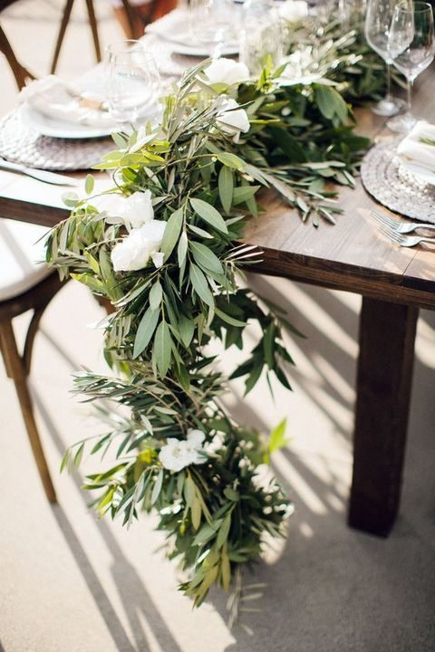 green leaves and white flowers will refresh any table