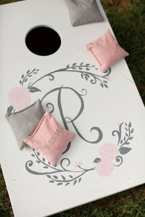 grey, ivory and blush cornhole games for the wedding