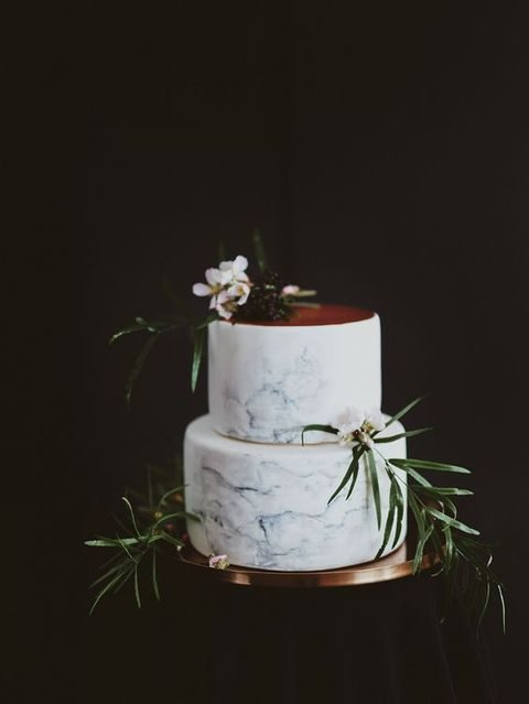 grey marble and copper cake topped with flowers and foliage