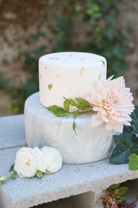 grey marble and wwhite with gold leaf cake and a blush dahlia