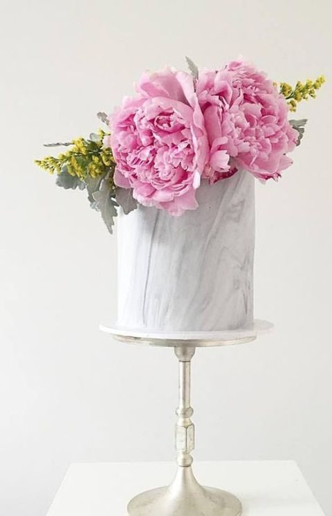 grey marble wedding cake with lush pink peonies