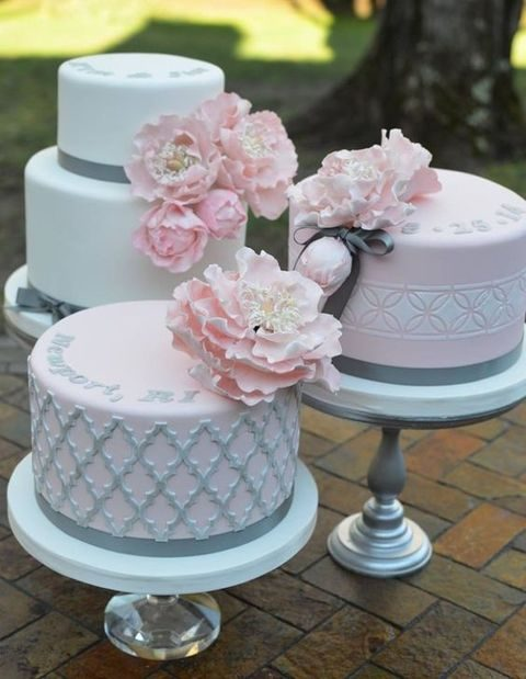 grey, pink and ivory wedding cakes with blooms
