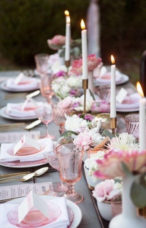 grey, pink and peach table setting with gilded candle holders