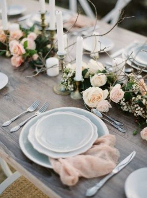 grey plates and chargers and subtle blush touches for a delicate table setting