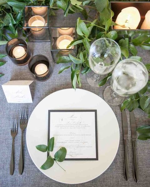 grey tablecloth, foliage, candles for a modern black tie wedding