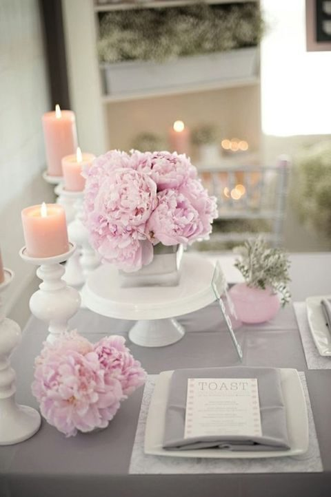 grey tablescape with lush pink peonies and candles