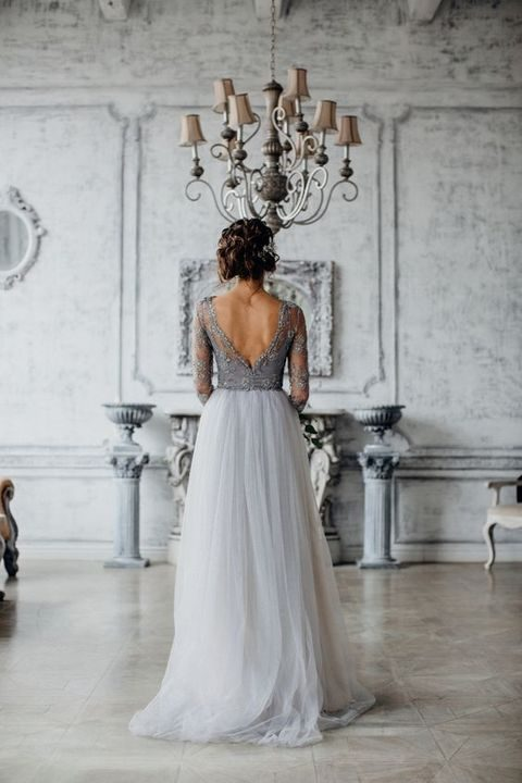 grey wedding dress with a low back cut