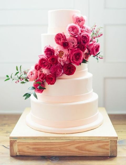 hot pink roses transform a plain white cake into a chic one