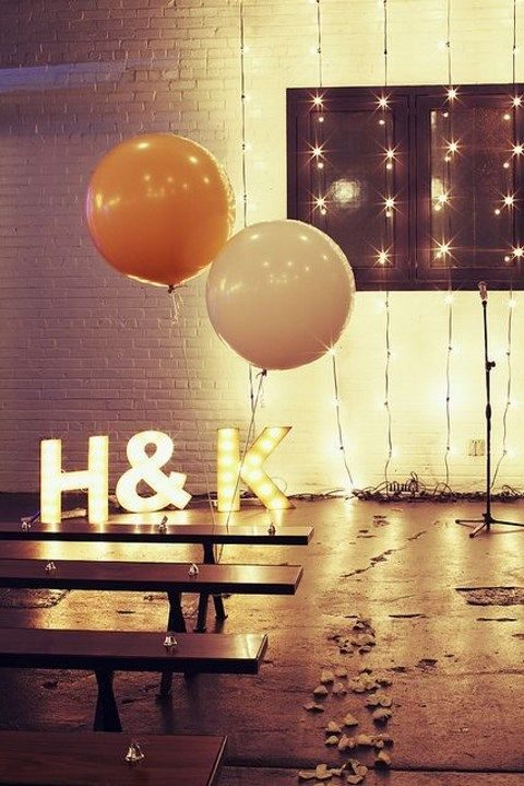 initials, balloons and lights for the ceremony spot