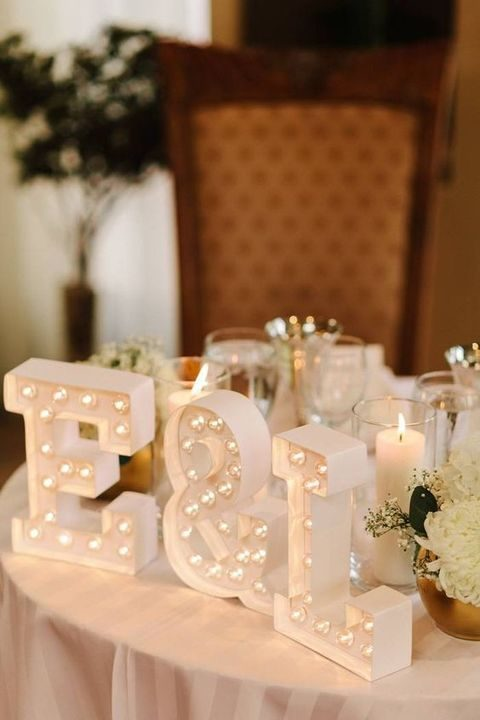 initials marquee lights for decorating a sweetheart table