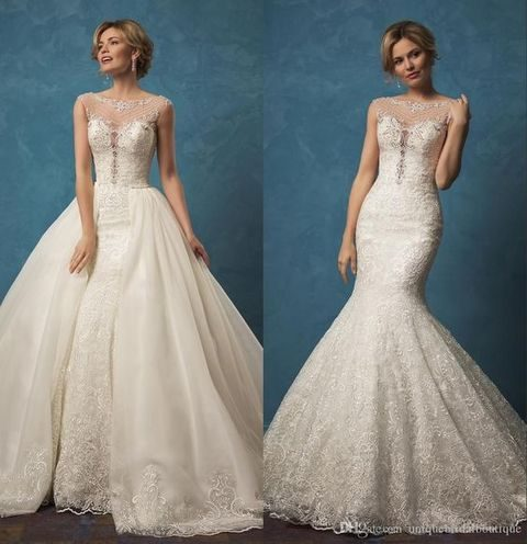 lace dress with an illusion neckline and a detachable skirt over a mermaid dress