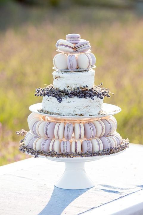 lavender macarons and a lightly frosted cake