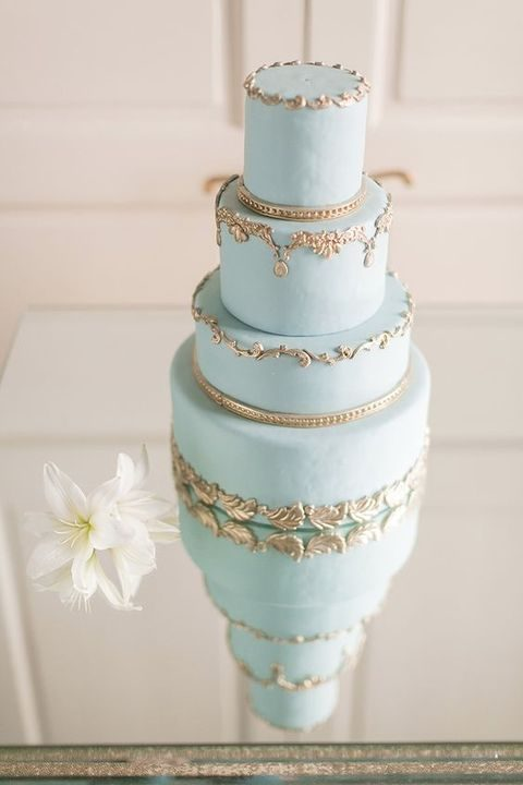 Light Blue Wedding Cake With Gold Lace Decor