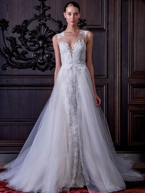 long lace wedding dress with a tulle skirt over it