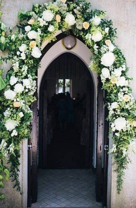 lush flower garland over the doors
