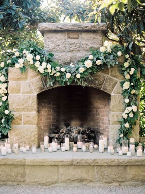 lush green and white garland to hang over a fireplace