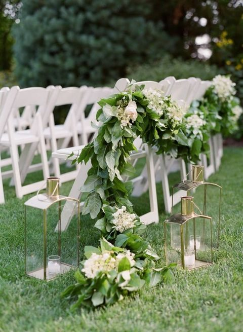 lush leaves and white flowers garland for decorating the aisle