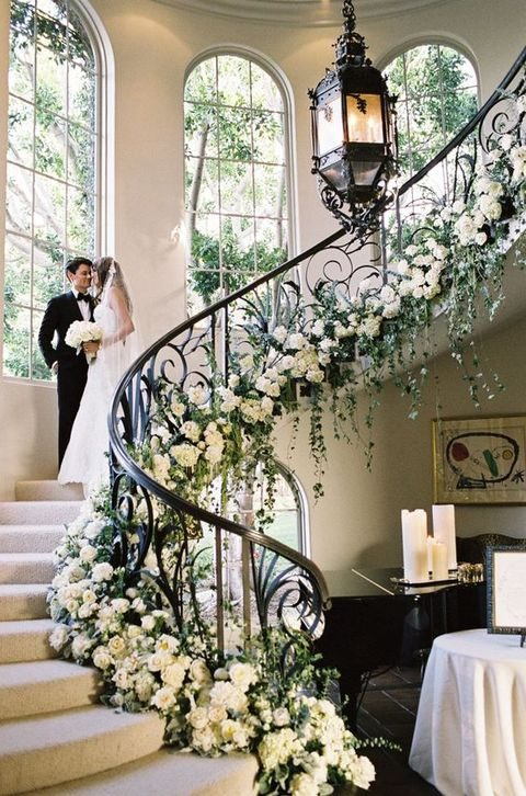 lush white roses and greenery stairs decor