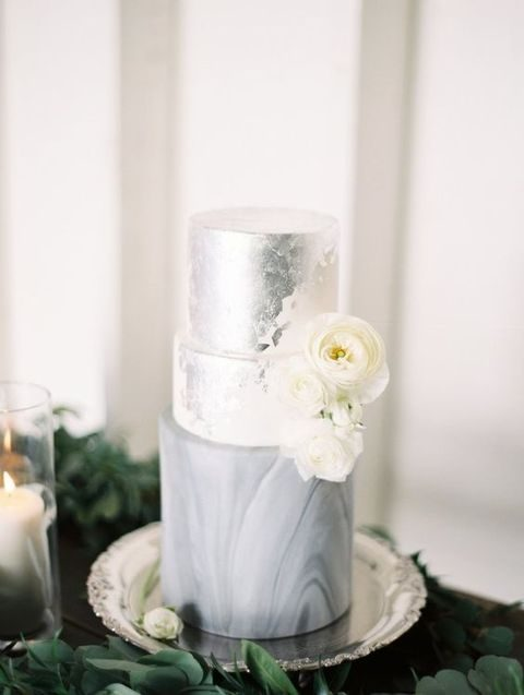 marble cake with a silver layer and ivory flowers