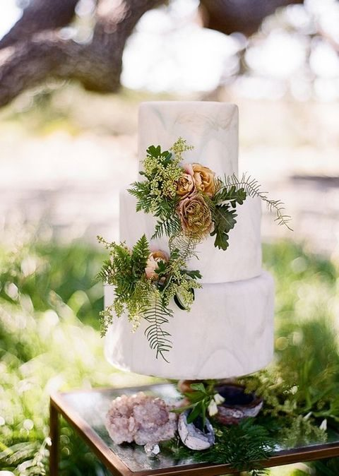 marble wedidng cake with foliage and flowers