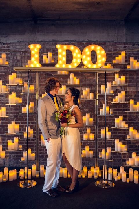 marquee letters and illuminated candles for a wedding backdrop