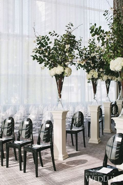 modern black and lucite chairs for the aisle