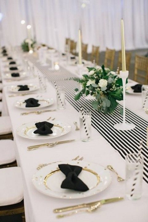 modern black and white table setting with gold touches