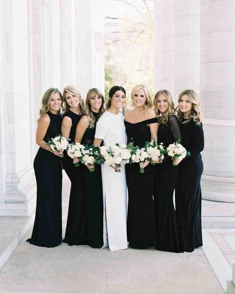 modern bridesmaids black dresses and the bride in a plain white gown