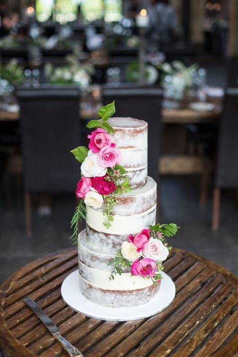 multi-tier wedding cake with colorful flowers