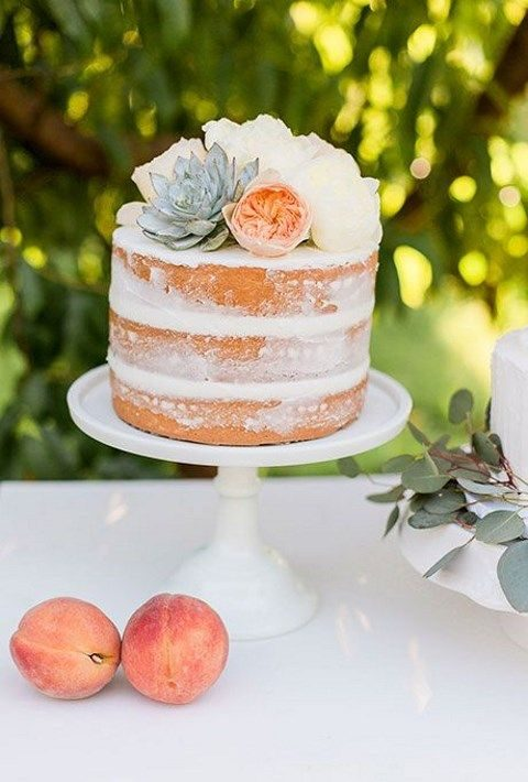one-tier naked wedding cake topped with fresh flowers and succulents