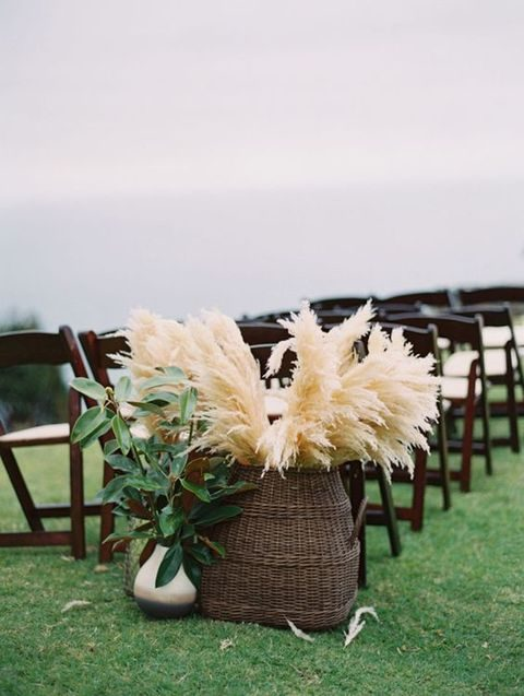 pampas grass in a wicker basket for the end of aisle details