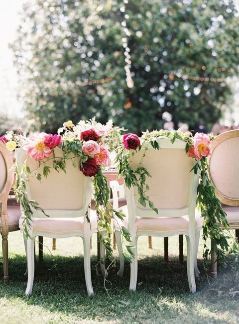 peony and green garland topped chairs
