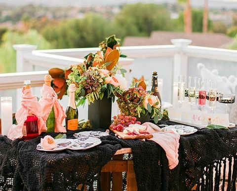 pink and black champagne tasting table